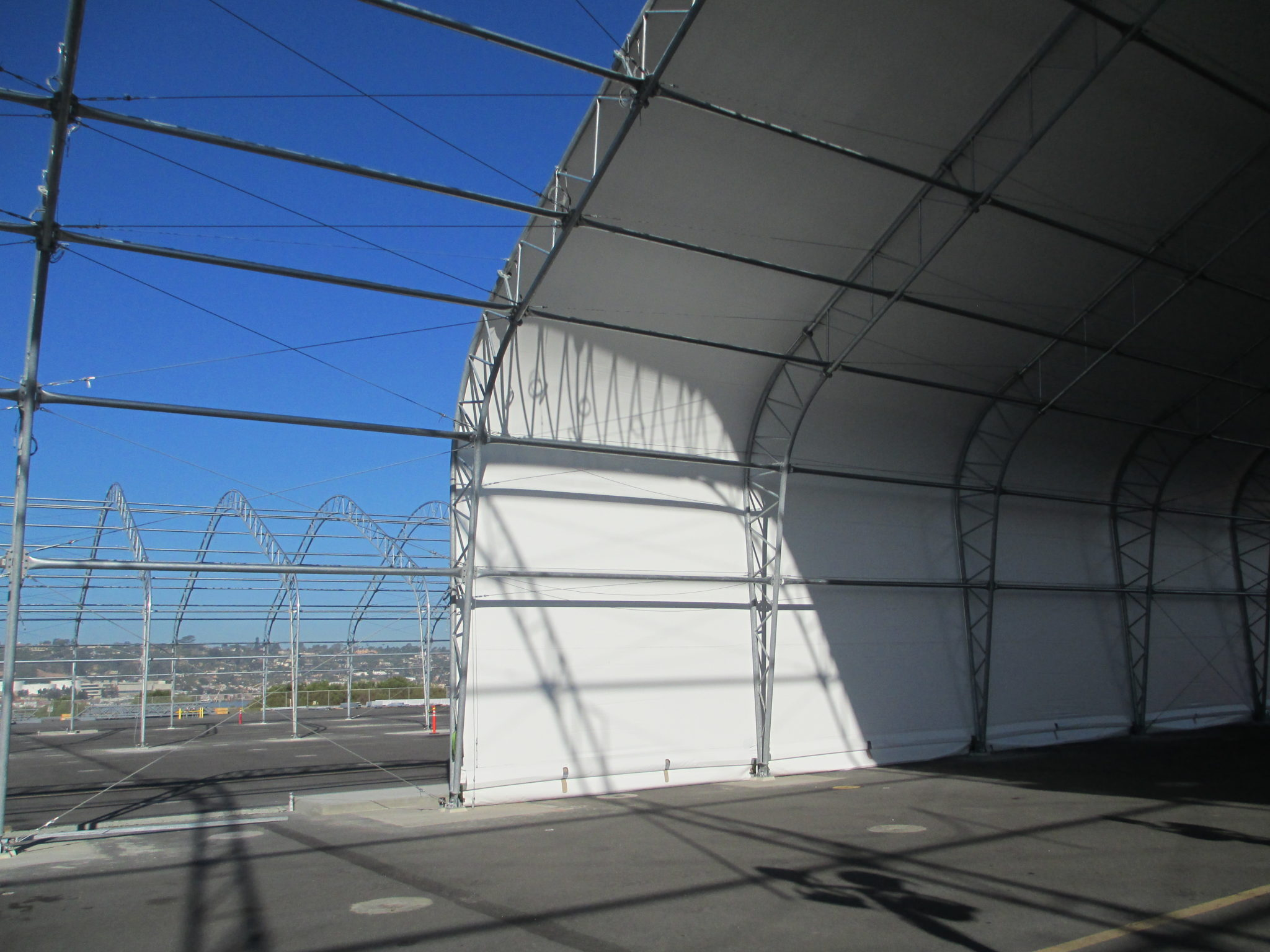 Aircraft shelter covered in white fabric